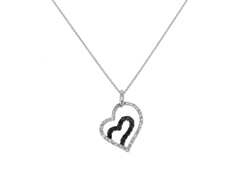 Open heart pave set black and white diamond pendant in 18 K gold