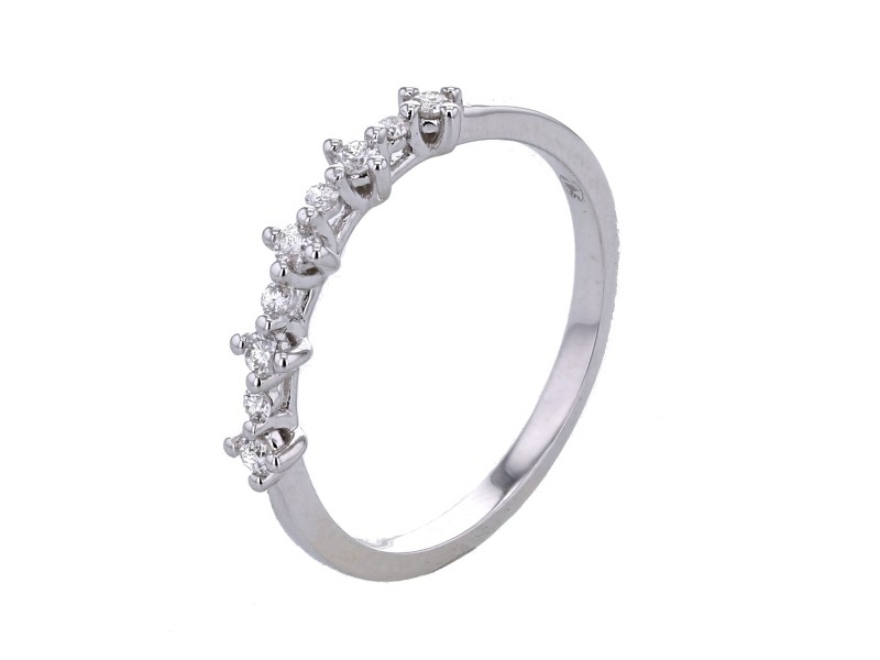 Wedding ring with claw set diamonds in 9 K gold
