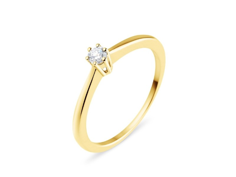 Classic claw set diamond solitaire ring in 18 K gold
