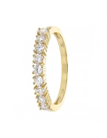 Claw set diamond wedding ring in 18 K gold