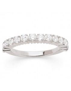 Claw set diamond wedding ring in 18 K gold