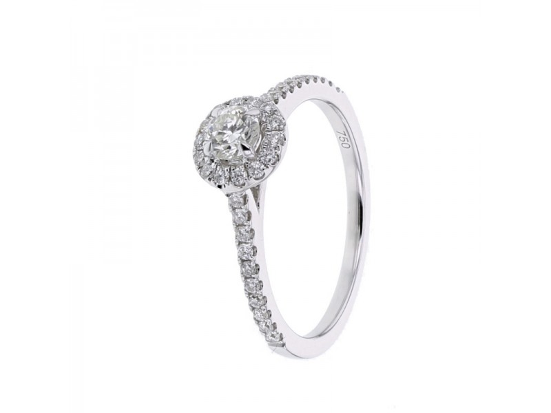 Diamond halo engagement solitaire ring in 18 K gold